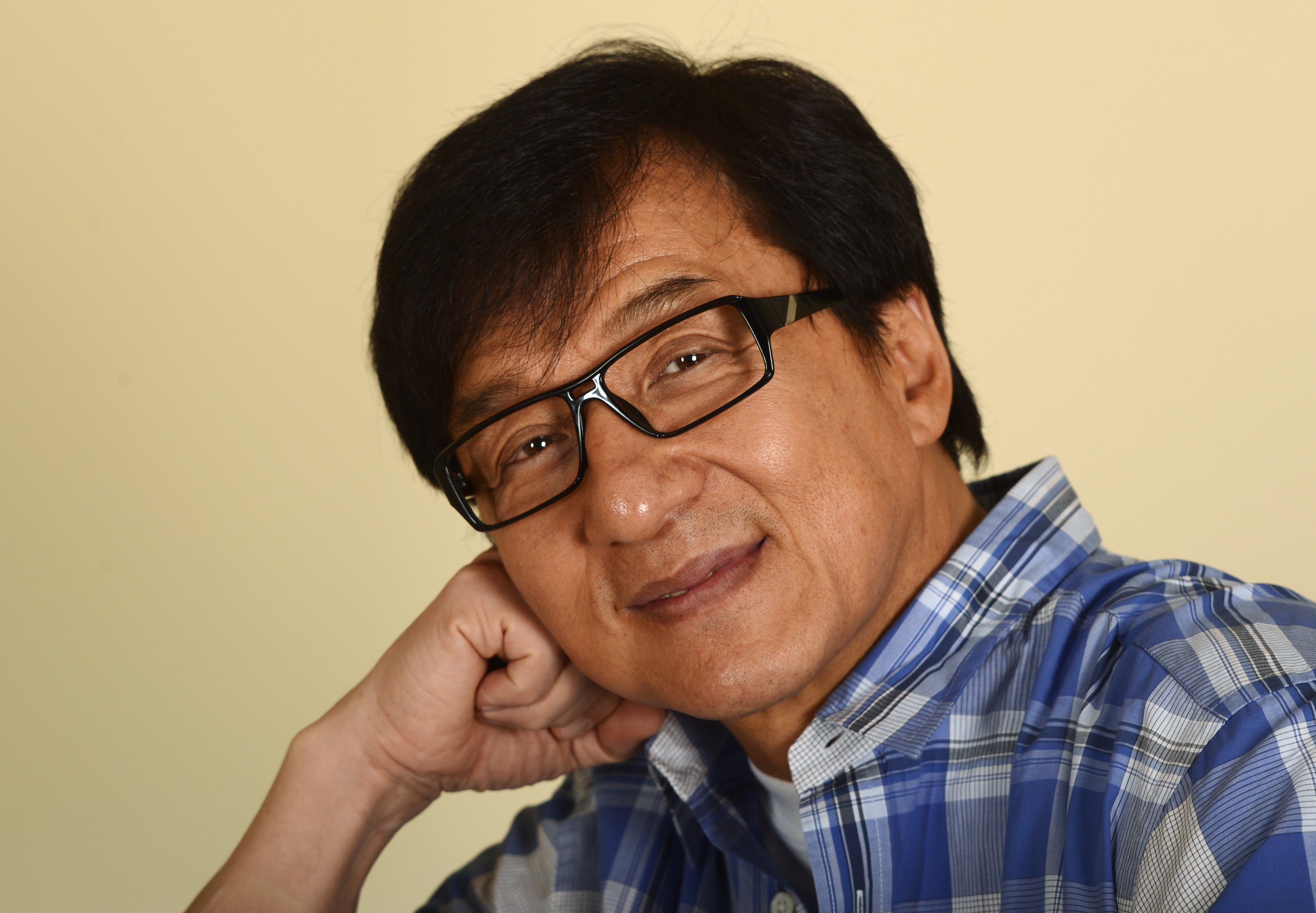 """Hong Kong actor Jackie Chan poses during a promotional event for his film """"Chinese Zodiac"""" in Beverly Hills, California October 16, 2013. Hong Kong martial arts film star Chan, 59, who declared last year at France's Cannes film festival that he was retiring from action films, now says that after more than a decade of contemplating quitting, he is going to let his body decide. As Chan starts to enter his twilight years he laments how Hollywood typecasting may force him to begin using a stunt double for his acrobatic scenes as he believes Hollywood studios would never cast him in dramatic roles. Picture taken October 16, 2013. To match story PEOPLE-JACKIECHAN/      REUTERS/Phil McCarten (UNITED STATES - Tags: ENTERTAINMENT PROFILE HEADSHOT)"""
